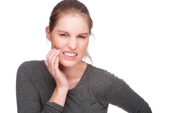 Опухоль после удалили зуб